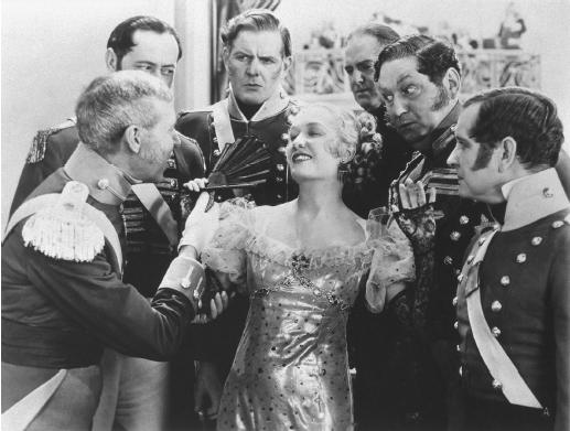 Miriam Hopkins enjoys the attention of several admirers.