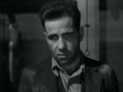 A grumpy Humphrey Bogart don't like no back talk.