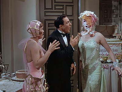 L_R: Debbie Reynolds, Gene Kelly, Jean Hagen. Notice Jean was able to keep the cascading cake from dropping on her dress. What a pro!