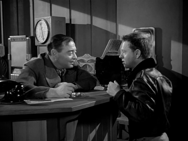 Mickey Rooney (right) tries to not strangle Peter Lorre (left).