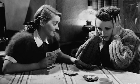 Mary Astor (right) is sick of Bette Davis' cheerful smothering.