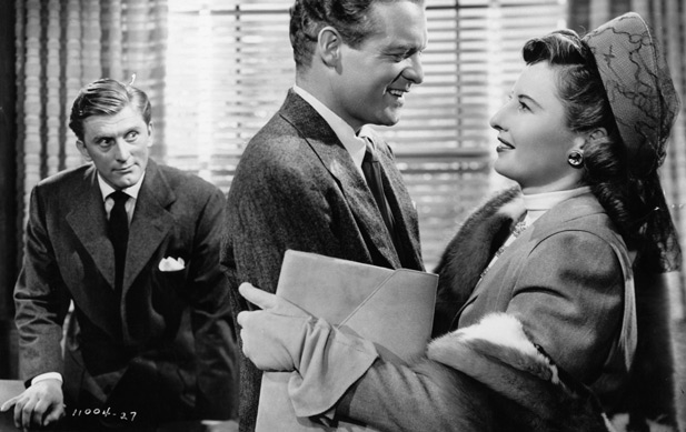Barbara Stanwyck is waaay too happy to see Van Heflin (right). Image: Biography