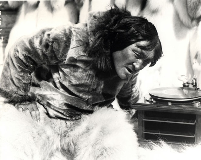 Nanook listens to a photograph for the first time. Image: jf sklfjsdj