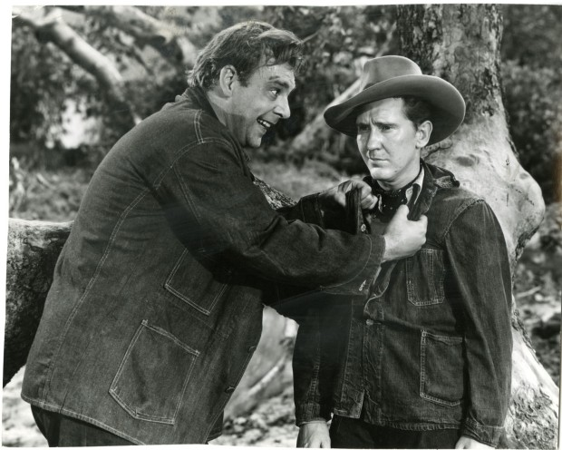 Lenny (Lon Chaney, Jr., left) asks George (Burgess Meredith) when they're getting the rabbits. Image: ksdjf lskdj f