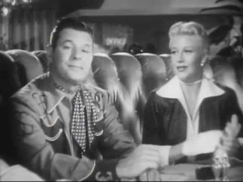 Jack Carson listens as Ginger Rogers blah blah. Image: YouTube