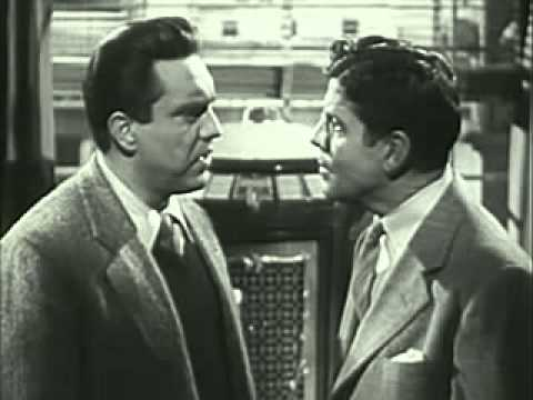 Rudy Vallee (right) threatens Edmund O'Brien with a job if he doesn't behave. Image: sjad askjf sdkj