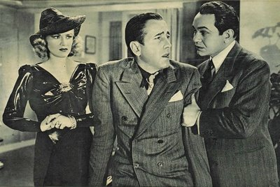 Humprey Bogart (centre) suddenly feels ill after trying to Blackmail Edward G. Robinson (left). Image: aldfkj