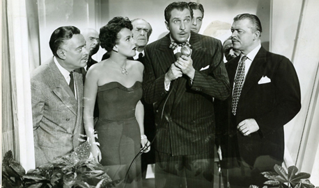 Vincent Price (centre, clutching heart) is surrounded by his Yes People. Image: ldsjf eiofj