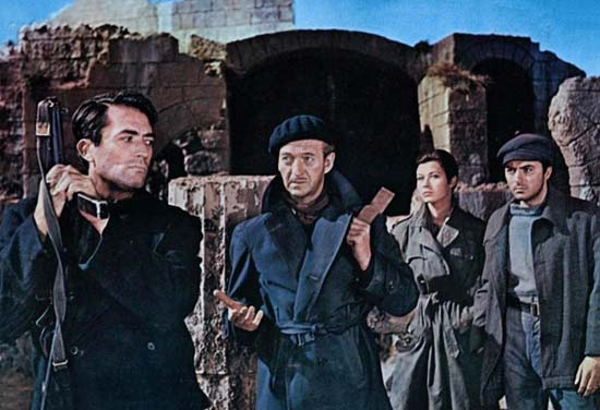 David Niven, centre, starts in on Gregory Peck. Image: britannica.com