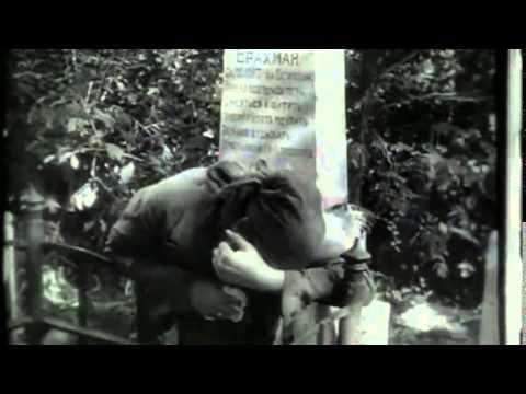 A woman weeps at a grave site. Image: lsdkjf alksdfj sdjkf