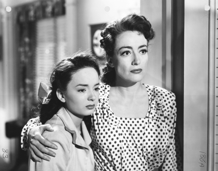 Blyth with on-screen mother, Joan Crawford. Image: laksdjf desk