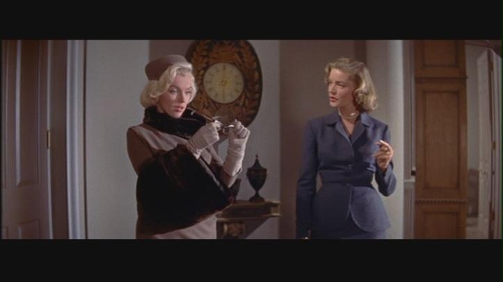 Bacall coaches Marilyn Monroe. Image: Fan Pop