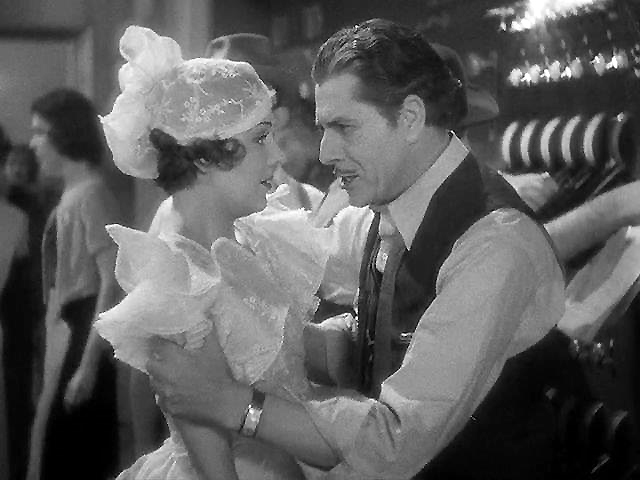 Warner Baxter (left) begs Ruby Keeler not to fail. Image: lsdkjf dks