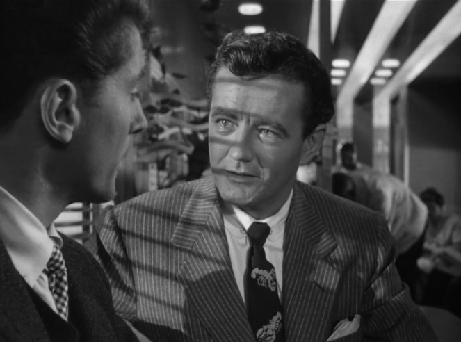 Robert Walker (centre) tries to sell Farley Granger on murder. Image: lsdkjf
