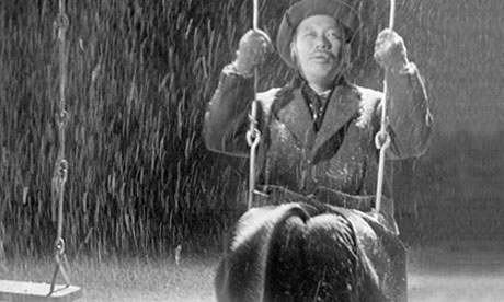Mr Watanabe (___) swings in a park that he built. Image: The Guardian
