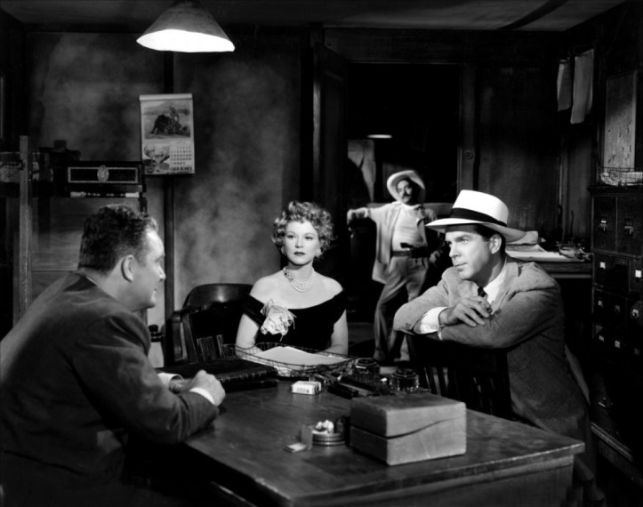 It's up to Claire Trevor (centre) to take down a Mexican drug ring. Image: Wikipedia