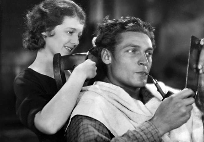 Janet Gaynor cuts ___ hair. Image: