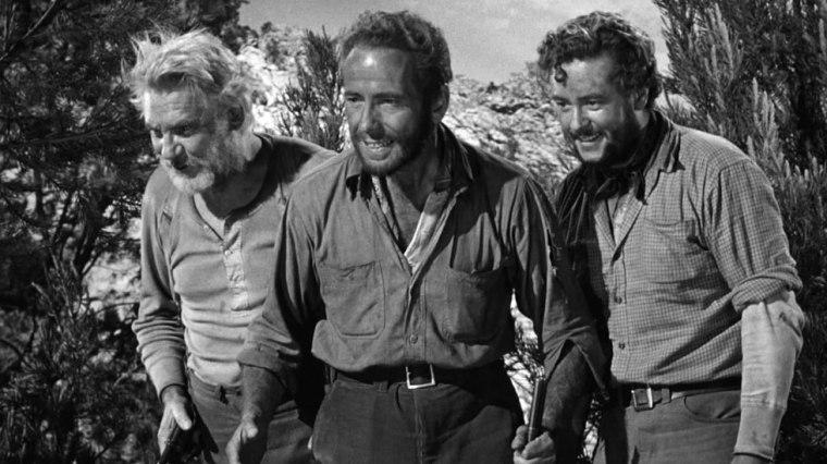 Walter Huston (left) mentors Humphrey Bogart (centre) and Tim Holt. Image: