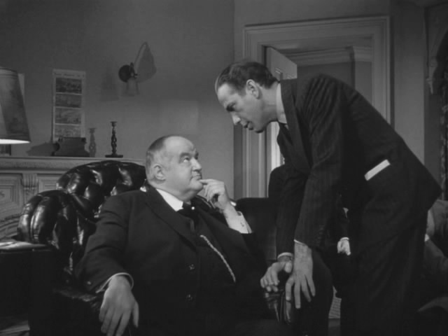 Humphrey Bogart (standing) makes a deal with Sidney Greenstreet. Image: