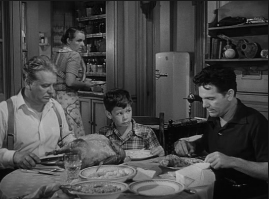 Wallace Ford (left) refuses to eat Garfield's turkey dinner; Image: RavePad