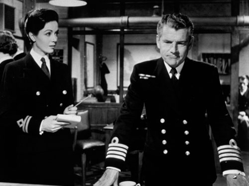 Dana Wynter and Kenneth More try to second-guess the Germans. Image: flammentanz.tumblr.com