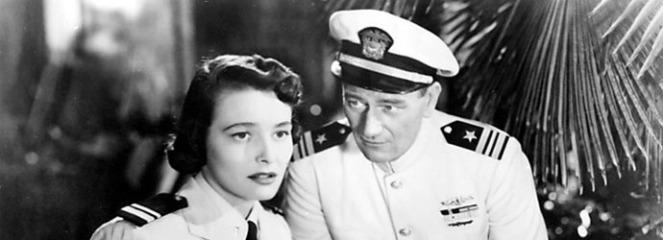 Wayne woos nurse Patricia Neal. Image: War Movies