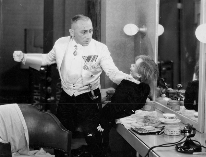 Erich von Stroheim takes a swing at his ventriloquist dummy. Image: Chicago Film Society