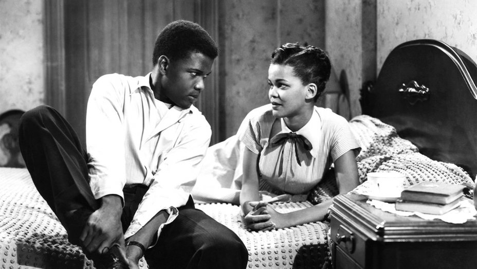 Sidney Poitier tells Mildred Joanne Smith not to worry. Image: Hollywood Reporter