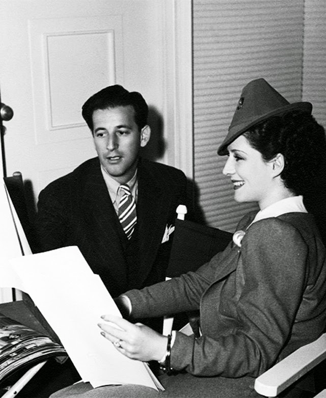 Norma Shearer discusses costume design with Adrian for The Women (1939). Image: Vintage Everyday