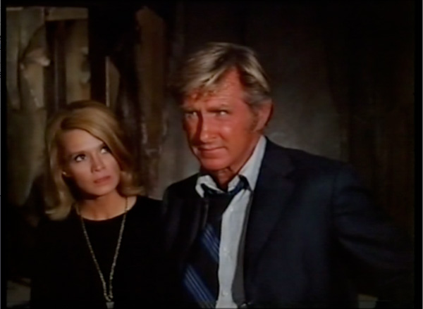 Angie Dickinson wants to know why Lloyd Bridges is so strange. Image: Modcinema