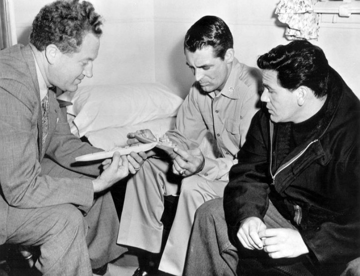 Garfield with director Delmer Daws (L) and Cary Grant on the set. Image: IMDB